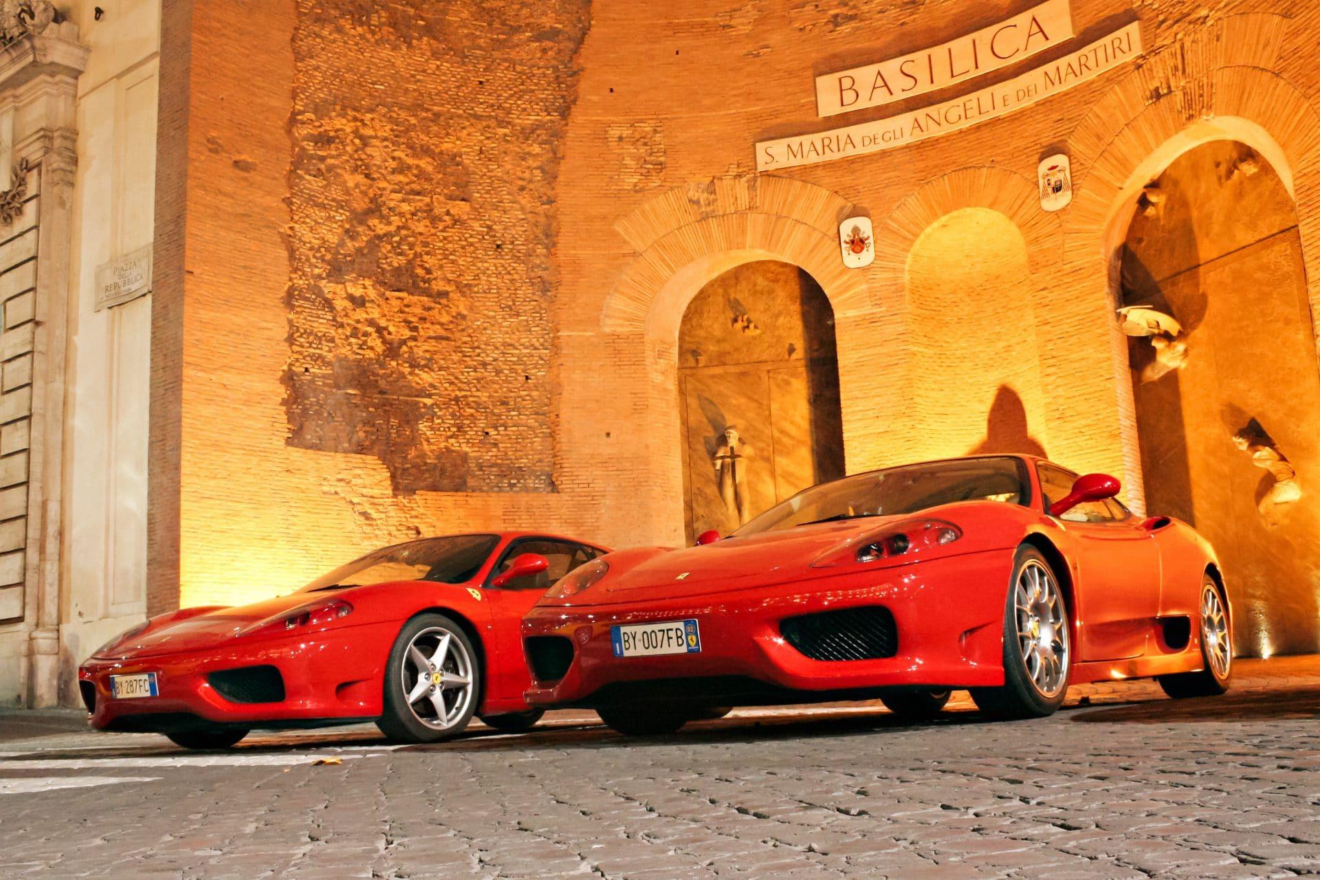 Two red Ferraris at Piazza della Repubblica in Rome