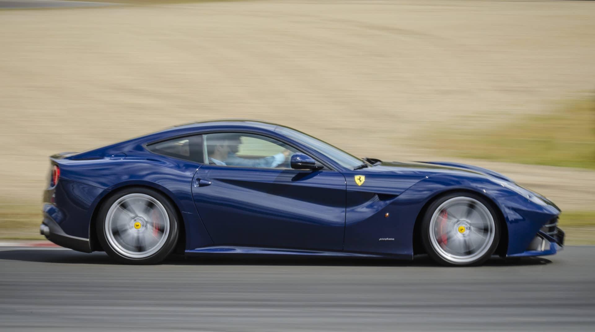 Ferrari F12 Berlinetta sports car driving fast